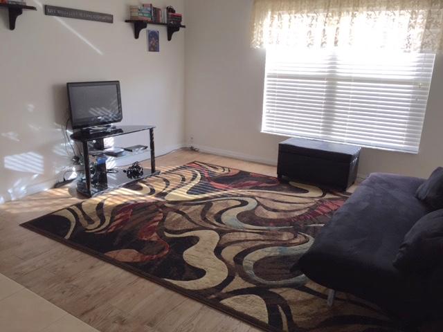 167 Carrera - Solana - Living Room - Pilgrim Homes Florida